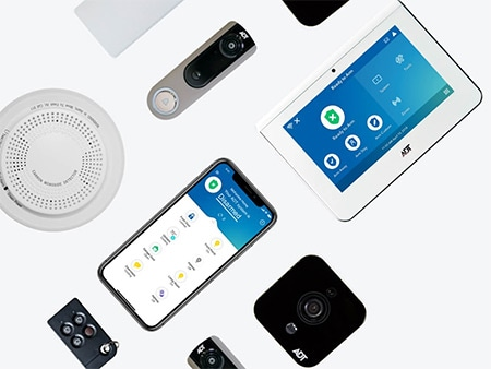 Examples of ADT Pulse equipment: keypad, sensors, doorbell camera, indoor camera, smoke detector, smartphone app, and keychain remote.