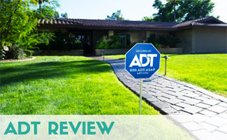 ADT yard sign in yard (caption: ADT Review)