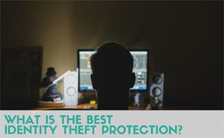 Man on computer in the dark: What is the Best Identity Theft Protection?