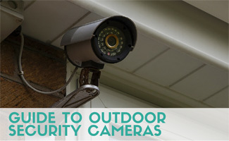 Outdoor security camera mounted to wall (Caption: Guide To Outdoor Security Cameras)