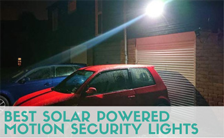 Car parked next to garage at night with light on (Caption: Best Solar Powered Motion Security Lights)