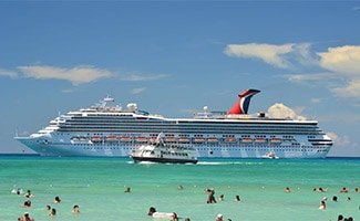 Carnival Cruise Lines boat in ocean with people swimming