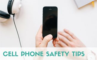 Person holding iphone: Cell Phone Safety Tips