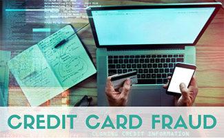 Hacker using stolen credit card at desk (caption: Credit Card Fraud)