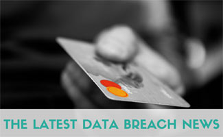 Person's hand with credit card: The Latest Data Breach News