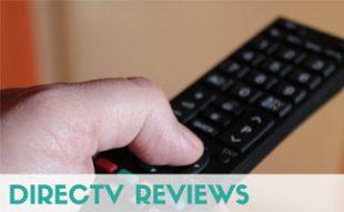 Man pushing button on TV remote