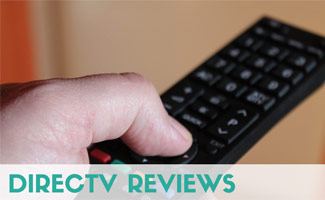 Man pushing button on TV remote