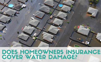 Overhead shot of houses flooded (text in image: Does Homeowners Insurance Cover Water Damage?)