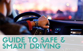 Man driving car behind wheel (caption: Guide To Safe & Smart Driving)