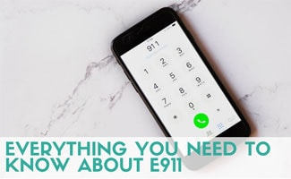 Phone with E911 on screen (caption: everything you need to know about E911)