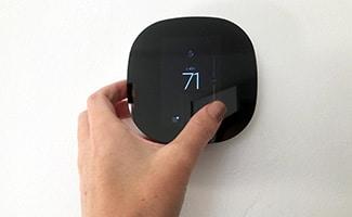 ecobee lite 3 with hand adjusting temperature