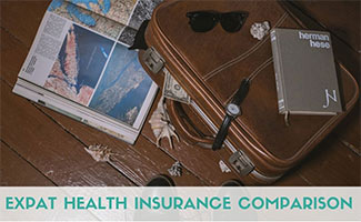 Suitcase with papers and book (caption: Expat Health Insurance Comparison)