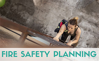 Girl climbing down escape ladder (Fire Safety Planning)