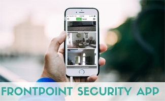 Person holding iPhone with Frontpoint App on screen (caption: Frontpoint Security App)
