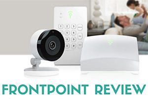 Family on sofa with security camera and eqiupment on table (caption: Frontpoint Review)