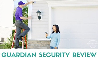 Guardian installer putting up outdoor security camera (caption: Guardian Security Review)