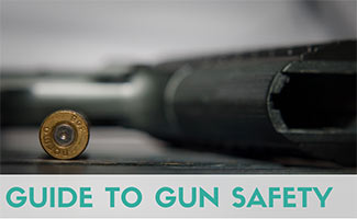 Gun and bullet on table (caption: Guide to Gun Safety)