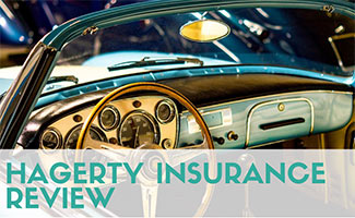 Classic car with top down (caption: Hagerty Insurance Review)