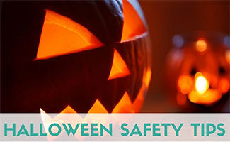 Jack-o'-lanterns lit up (Caption: Halloween Safety Tips)