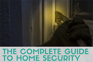 Person prying window open (caption: The complete guide to home security)