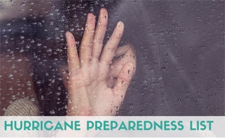 Girl crying and holding her hand up to rainy window (Caption: Hurricane Preparedness List)