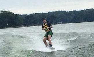 Man water skiing on lake