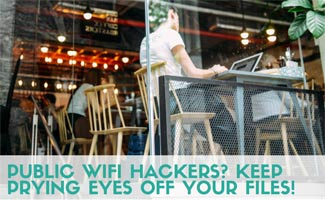 Person in coffee shop on computer: Public Wifi Hackers? Keep Prying Eyes Off Your Files!