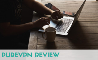 Person browsing computer with coffee: PureVPN Review