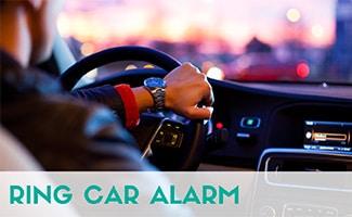 Man driving car (caption: Ring Car Alarm)
