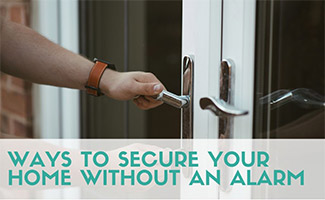 Person locking doors (caption: Ways To Secure Your Home Without An Alarm)