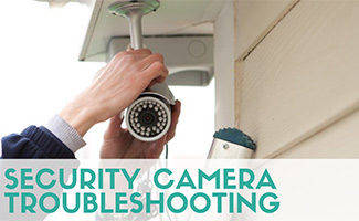 Personal fixing wires on security camera outside (caption: Security Camera Troubleshooting)
