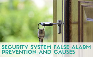 Home front door open with keys in lock (caption: False Alarm Prevention and Causes)