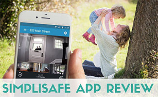 Family at the park looking at Simplisafe camera from phone (caption: SimpliSafe App Review)