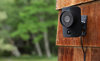 SimpliSafe Camera Outdoor Kit on outside of home