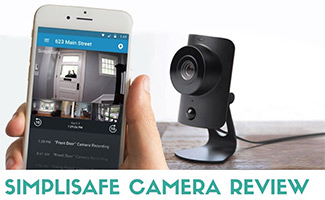 Simplisafe camera on table with app in front on phone in hand (caption: SimpliSafe Camera Review)