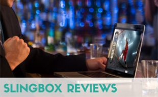 Man watching TV on computer in bar: Slingbox Reviews