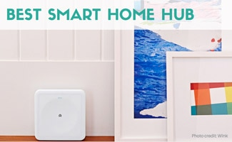 Wink smart hub sitting on the floor next to a couple abstract paintings. Caption: Best Smart Home Hub