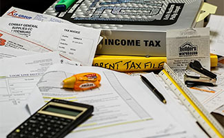 Taxes and papers on table