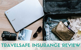 Computer next to suitcase (caption: TravelSafe Insurance Review)