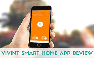 Man holding iPhone with Vivint App on screen (caption: Vivint Smart Home App Review)