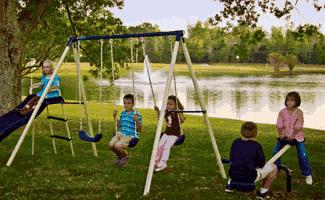 Kids playing on Triple Fun Metal Swing Set Review
