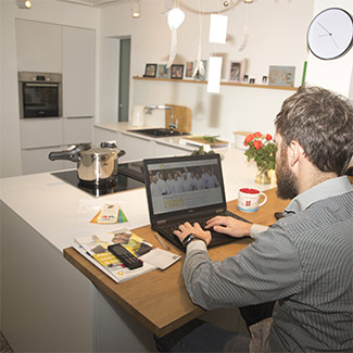 Man working from kitchen counter