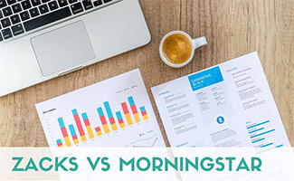 Investing papers on a desk next to computer (caption: Zacks vs Morningstar)